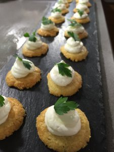 Whipped Goats Cheese with Lemon on Parmesan Biscuits Canapés